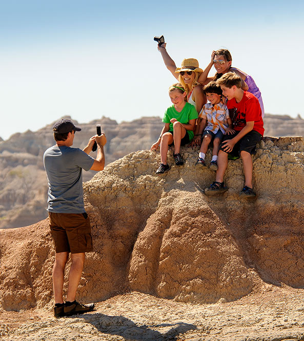 Dad Taking Picture of Family