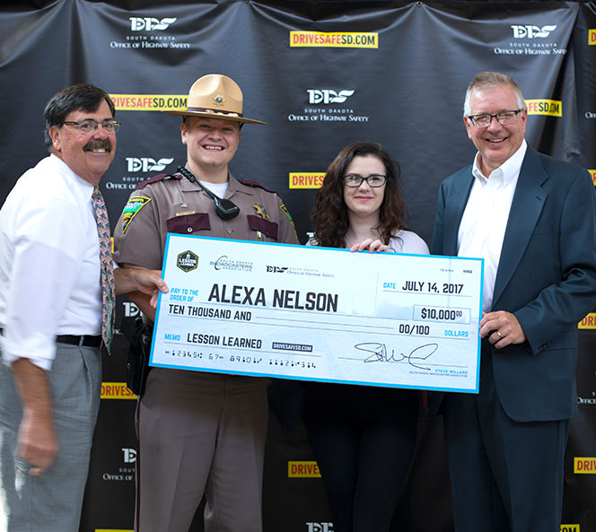 Alexa being awarded check
